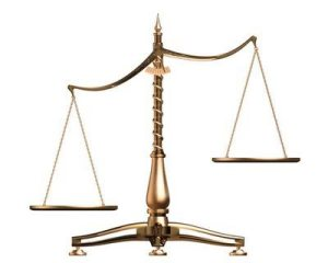 15108_brass_scales_of_justice_off_balance_symbolizing_injustice_over_white